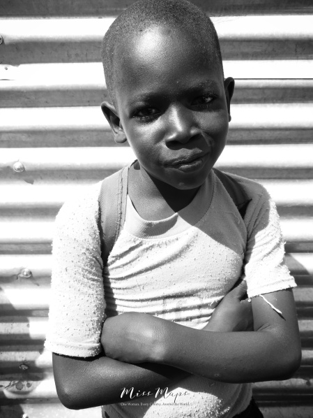 School Boy in Black and White 3 - Rucinga Island Kenya - by Anika Mikkelson - Miss Maps - www.MissMaps.com