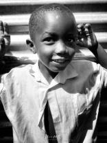 School Boy in Black and White 4 - Rucinga Island Kenya - by Anika Mikkelson - Miss Maps - www.MissMaps.com