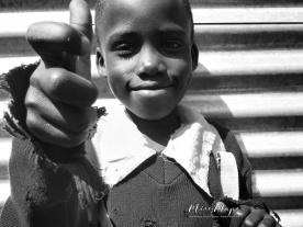School Boy in Black and White 6 - Rucinga Island Kenya - by Anika Mikkelson - Miss Maps - www.MissMaps.com