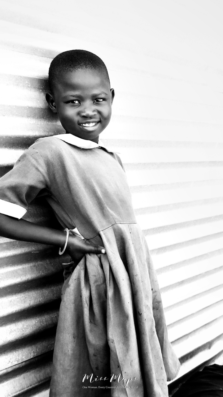 School Girl in Black and White 1 - Rucinga Island Kenya - by Anika Mikkelson - Miss Maps - www.MissMaps.com