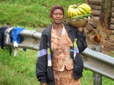 Woman Selling Bananas near Queen Elizabeth National Park - Uganda - by Anika Mikkelson - Miss Maps - www.MissMaps.com