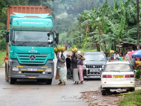Women Selling Bananas to Truckers - Near Queen Elizabeth National Park - Uganda - by Anika Mikkelson - Miss Maps - www.MissMaps.com