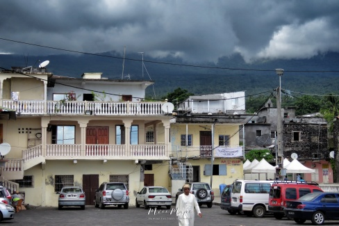 Shops and Clouded Mountains - Moroni - Comoros - by Anika Mikkelson - Miss Maps - www.MissMaps.com