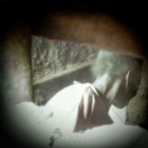 Woman through the smoke hole of a mud hut - Jinja Uganda - by Anika Mikkelson - Miss Maps - www.MissMaps.com