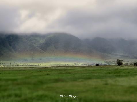 Short Rainbow Across the Crater - Ngorongoro Crater - Tanzania - by Anika Mikkelson - Miss Maps - www.MissMaps.com