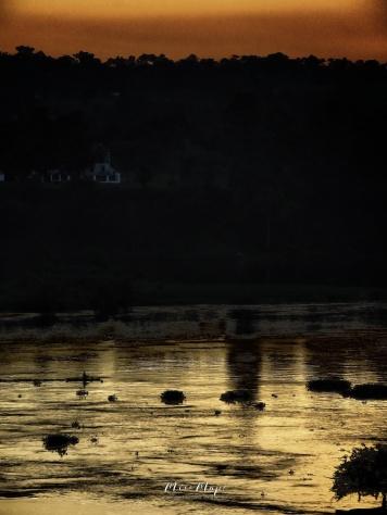 Sunset over the Nile River - Jinja Uganda - by Anika Mikkelson - Miss Maps - www.MissMaps.com