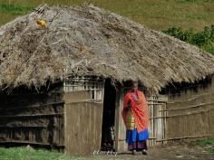 Maasai Woman Outside Her Home - Near Ngorongoro Crater Tanzania - by Anika Mikkelson - Miss Maps - www.MissMaps.com