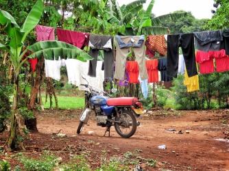 Clothes and Motorbike - Jinja Uganda - by Anika Mikkelson - Miss Maps - www.MissMaps.com