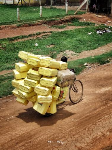 Bicycle Rider - Jinja Uganda - by Anika Mikkelson - Miss Maps - www.MissMaps.com