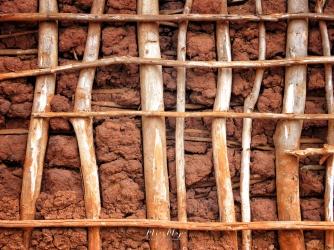 Close look at mud hut walls - Jinja Uganda - by Anika Mikkelson - Miss Maps - www.MissMaps.com