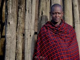 Man Outside His Home - Maasai Tribe Near Ngorongoro Crater Tanzania - by Anika Mikkelson - Miss Maps - www.MissMaps.com
